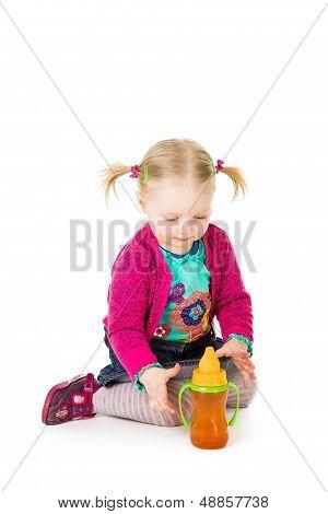 Baby Girl Drinking Tea From Bottle