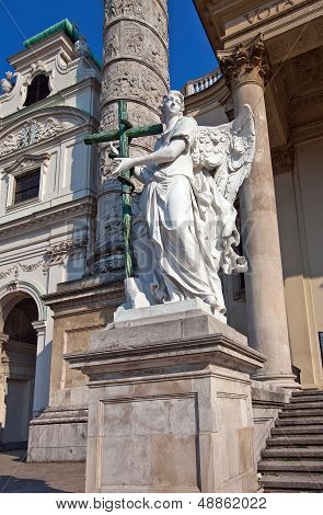 Statue of an angel in front of Saint Charles Church (Karlskirche 1737). Karlsplatz Vienna Austria poster