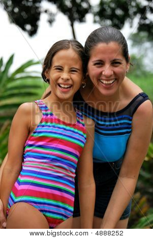 Hispanic Mother And Daughter Smile
