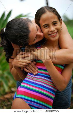 Mother Hugging Her Beautiful Daughter