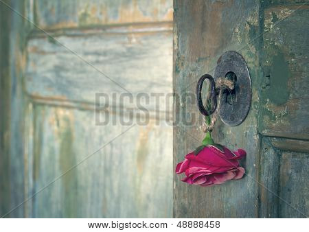 Red Rose Hanging From An Old Key