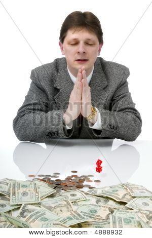 Man Praying For Dice