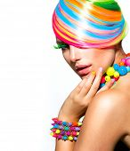 Beauty Girl Portrait with Colorful Makeup, Hair, Nail polish and Accessories. Colourful Studio Shot of Funny Woman. Vivid Colors. Manicure and Hairstyle. Rainbow Colors poster