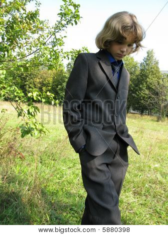 Young boy is on a meadow
