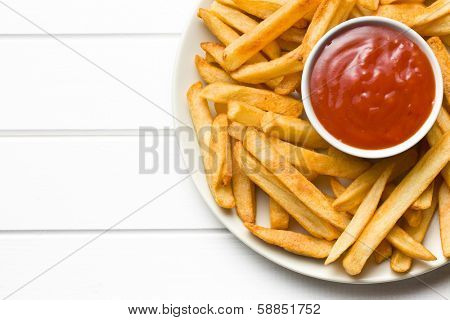 top view of french fries with ketchup on plate