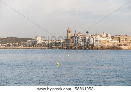 Sitges skyline as seen from the sea on southern Barcelona in Catalonia Province Spain poster