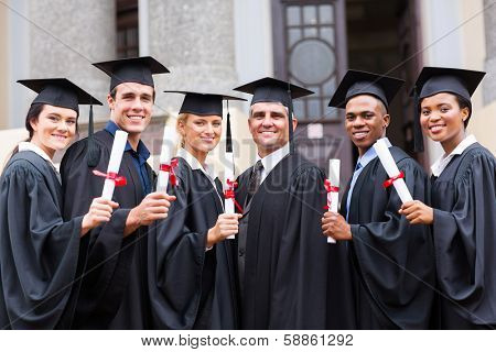 group of young college graduates and professor at graduation
