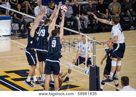 IRVINE, CA - JANUARY 17: The University of California Irvine's Jeremy Dejno spikes the ball in a volleyball match with Brigham Young University at the Bren Center in Irvine, CA on January 17, 2014