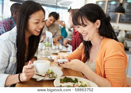Two Female Friends Friends Meeting For Lunch In Coffee Shop