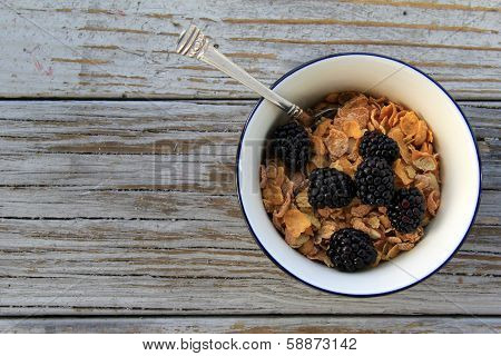 Bowl of Breakfast cereal and blackberries