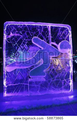 Perm, Russia - Jan 11, 2014: Illuminated Blue Skater Character Sculpture In Ice Town At Evening, Cre