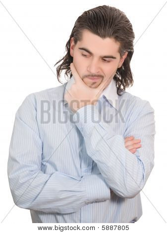 Young Handsome Unhappy Man Holds His Hand At Chin And Speculates Down Isolated White
