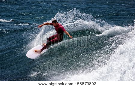 Aussie surfer riding a wave on a sunny day