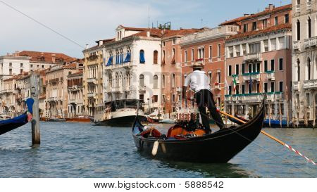 Gondolier On The Grand Canal In Venice, Italy