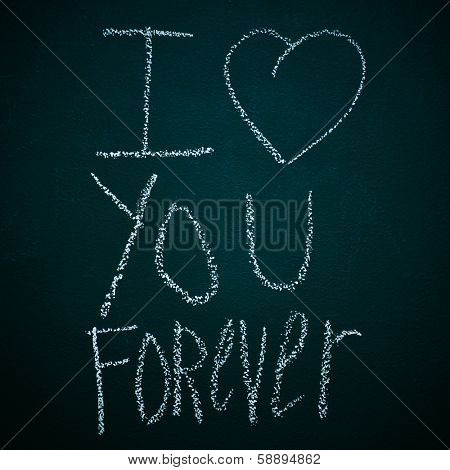 sentence I love you forever written with chalk in a chalkboard poster