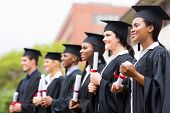 group of multiracial university graduates at graduation ceremony poster