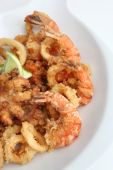 combination of seafood like calamari optopus srips, all fried poster