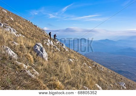 Two hikers on trekking through mountain Rtanj on a sunny day, central Serbia poster