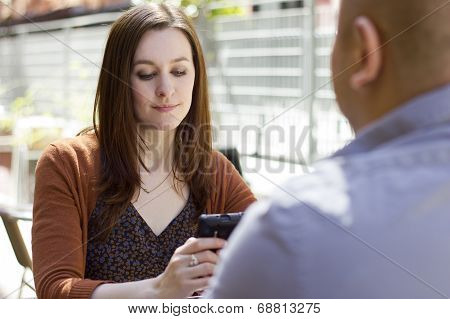 bored incompatible couple on an outdoor date outdoors poster