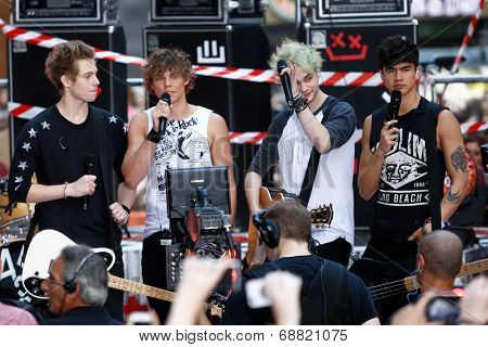 NEW YORK-JUL 22: (L-R) Luke Hemmings, Ashton Irwin, Michael Clifford and Calum Hood of 5 Seconds Of Summer on stage on NBC's 'Today Show' at Rockefeller Plaza on July 22, 2014 in New York City.