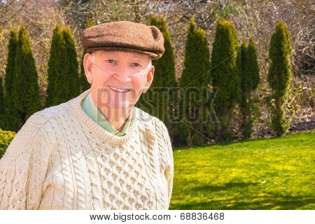 Smiling Older Man With Sweater and Hat