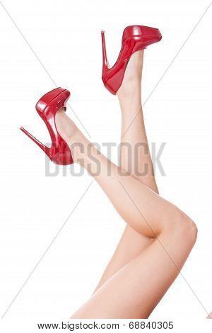 Sexy Bare Female Legs In Elegant Red Stilettos