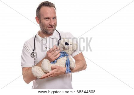 Smiling Pediatric Nurse With A Teddy Bear