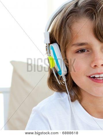 Cute Little Boy Listening Music With Headphones