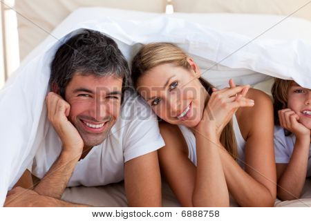 Loving Family Having Fun With On Bed