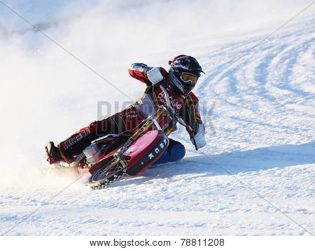 NOVOSIBIRSK, RUSSIA - DECEMBER 20, 2014: Evgeny Urakov of Izhevsk during the semi-final individual rides of Russian Ice Speedway Championship. The sports returns to the sport arenas after a decline
