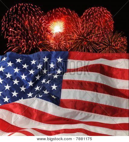 Ariel fireworks display behind a fluttering U/S. Flag. poster