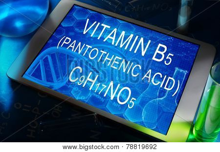the chemical formula of Vitamin B5 (pantothenic acid) on a tablet with test tubes poster