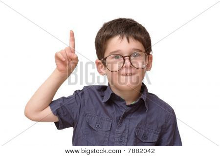 Little boy in funny round spectacles raising finger
