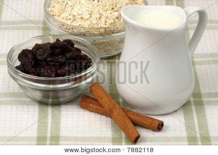 raw and healthy oat flakes with raisins and other oatmeal ingredients that are important on your daily nutrition to prevent high colesterol and heart dideases poster