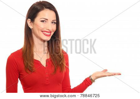 Attractive woman in red holding product with a hand isolated
