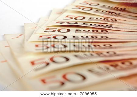 Stack of fifty euro notes blurred on foreground poster