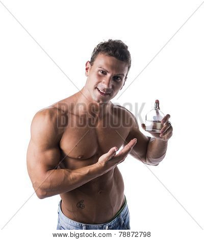 Shirtless muscular male model showing cologne or aftershave bottle on white background smiling poster
