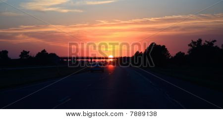 Sunset above the road
