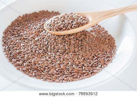 Brown Flax Seeds On A Wooden Spoon