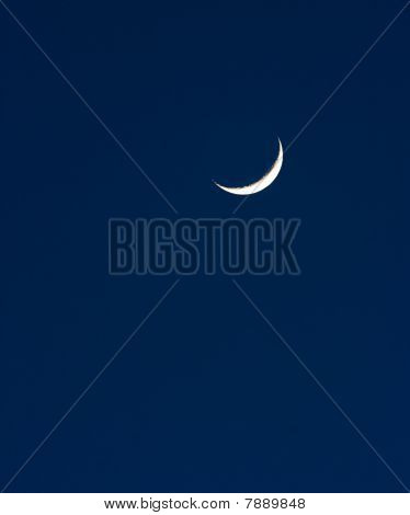 A Crescent Moon Hanging In The Night Sky