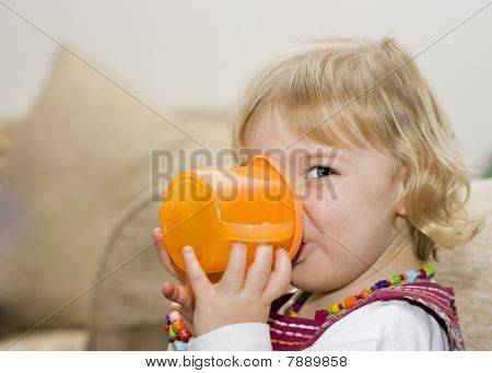 Toddler Girl Drinking From A Cup