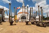 Ancient Thuparama Dagoba a huge white ancient stupa surrounded by stone pillars Anuradhapura Sri Lanka poster