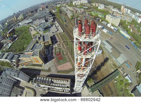 Tall tubes of boiler house near school and railway station at sunny day, aerial view