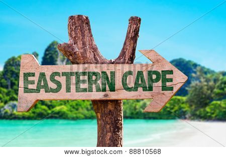 Eastern Cape wooden sign with beach background