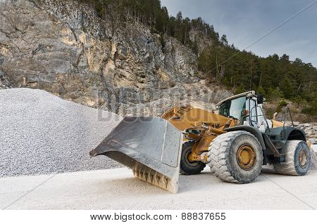 huge wheel mounted front loader at stone quarry