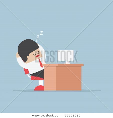 Tired Businessman Falls Asleep At His Desk