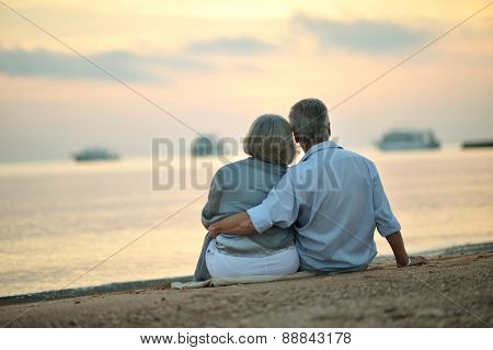 Mature couple relaxing on beach
