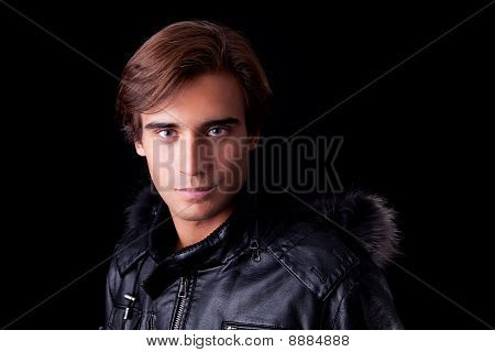 Portrait Of A Young Man, In Autumn/winter Clothes, Isolated On Black. Studio Shot