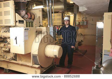 Generator  in a hospital with a repair men.