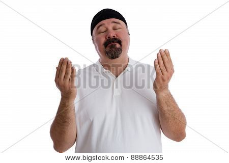 Devout religious middle-aged man deep in prayer standing with is eyes closed and hands raised in supplication isolated on white poster